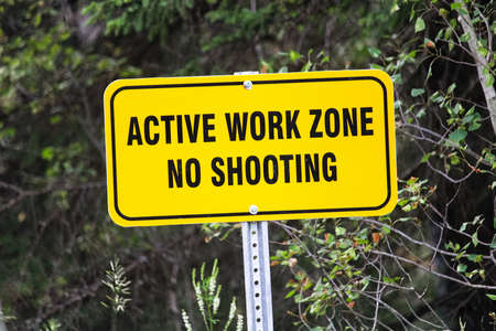 A active work zone no shooting sign