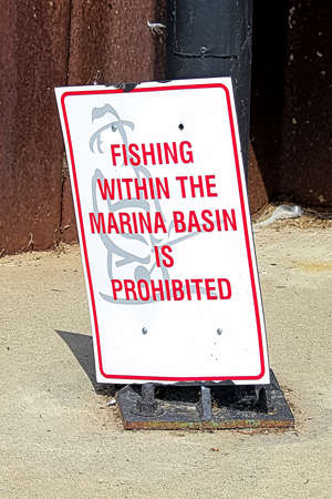 A fishing within the marina basin is prohibited sign