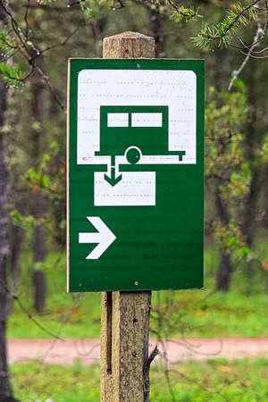 A green sani-dump sign with a direction arrow. Stock Photo