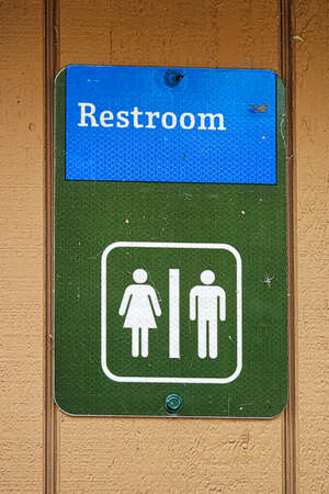 Closeup of a male and female restroom sign. Stock Photo