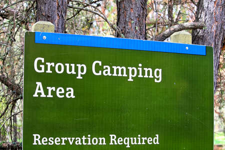 A group camping area sign indicating reservations are required.