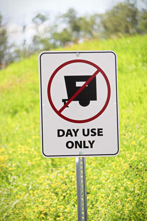Closeup of a day use only sign. Stock Photo