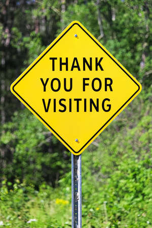 Closeup of a thank you for visiting sign.