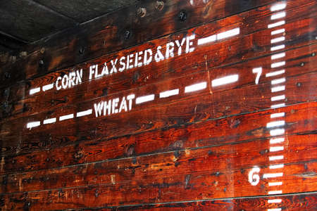 Height indicators for various grains in an old grain car.