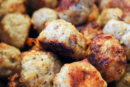 Closeup of a pile of baked meatballs