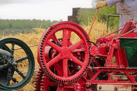 Wheels and gears on an old baling machine Banco de Imagens - 118477126