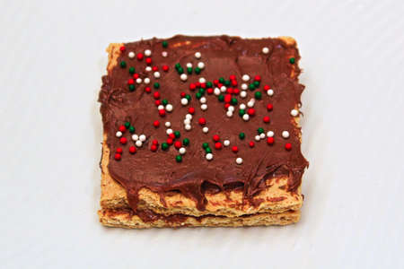 Closeup of grapham crackers spread with chocolate and sprinkles