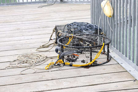 Crab traps with rope lay on a deck