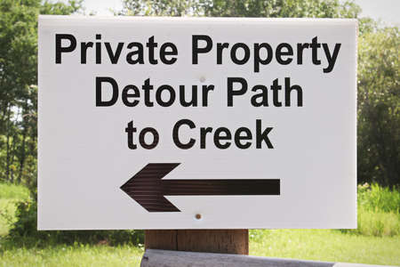 A private property detour path to creek sign Banco de Imagens
