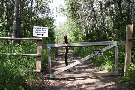 A private property detour path sign on a gate.