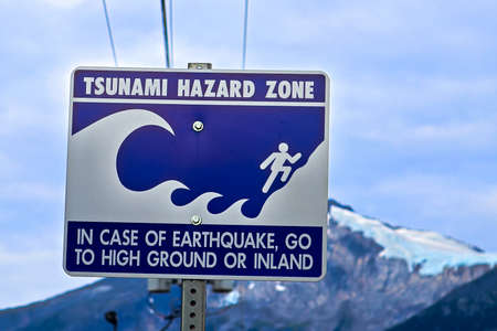 A tsunami hazard zone sign warning along the coast.