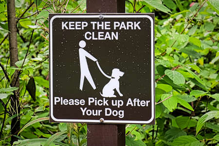 A keep the park clean pickup after your dog sign