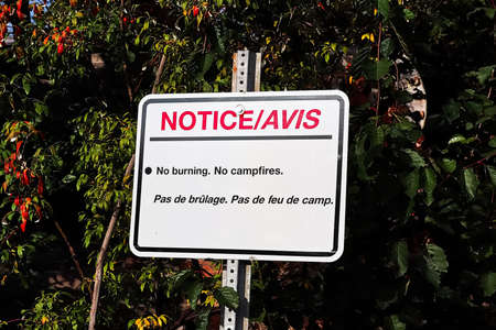 A notice no burning no campfires sign