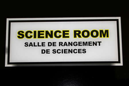 A science room sign outlined in yellow