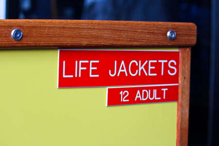 A life jackets 12 adult location indicator sign.