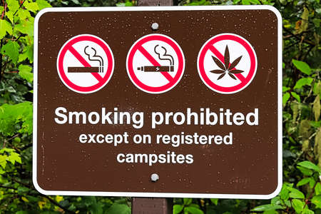A smoking prohibited except on registered campsite sign Banco de Imagens
