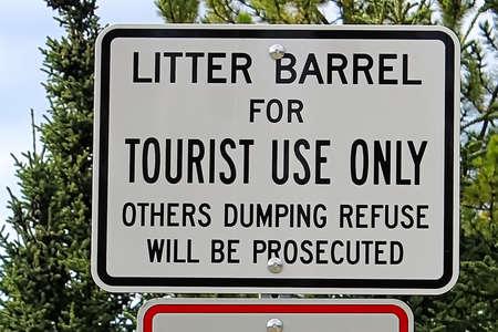 A litter barrel for tourist use only sign Banco de Imagens