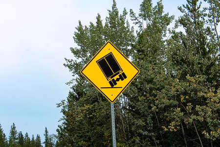 A truckers warning sign about tipping hazards