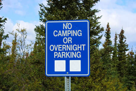 A no camping or overnight parking sign