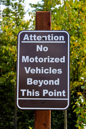 An attention no motorized vehciles beyond this point sign Banco de Imagens