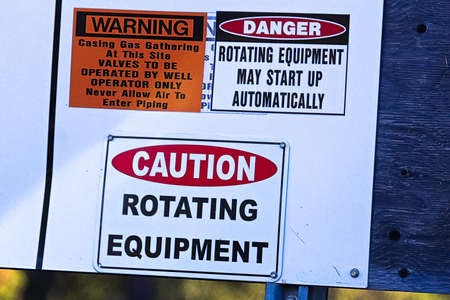 An industry caution rotating equipment warning sign