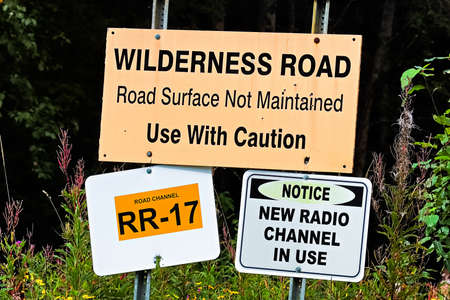 A wilderness road, use with caution sign
