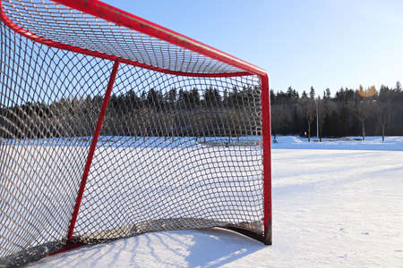 Side view of a hockey net on a skating pond Banco de Imagens