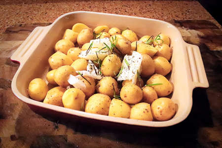 Closeup of baby potatoes about to go into the ove. Banco de Imagens