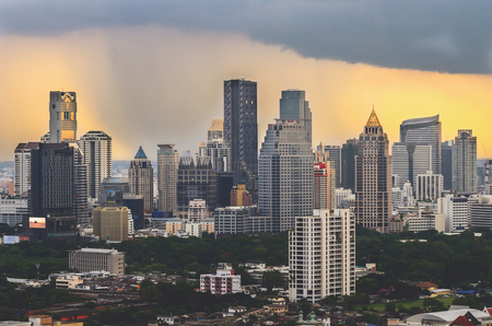 ariel: Ariel view of a Modern Commercial City  Bangkok Business District in storm Stock Photo