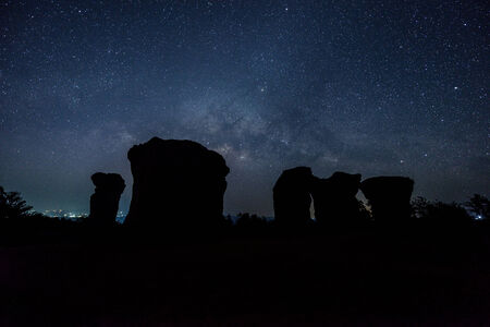 Milky Way rises over stone at Mor hin khao,Thailand photo