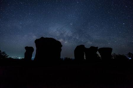 Milky Way rises over stone at Mor hin khao,Thailand Stock Photo