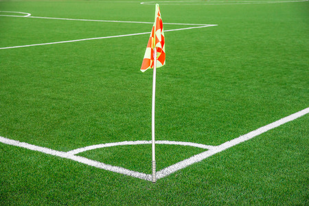 A flag at one corner of  football stadium photo