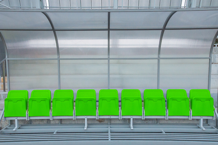 substitute: Green reserve and staff coach bench in sport stadium Stock Photo