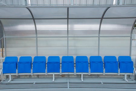 Blue reserve and staff coach bench in sport stadium photo