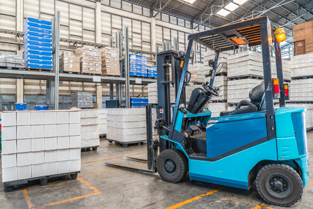 handle: forklift in the large modern warehouse
