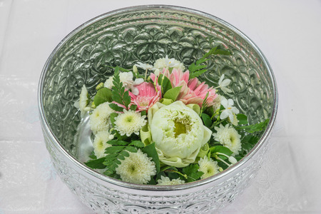 Lotus and Gerbera with Thai style decoration in silver bowl photo