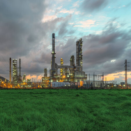 Petrochemical plant   oil refinery   industry at twilight time photo