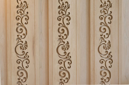 latticework: wooden latticework with thai style design creating a perforated wall
