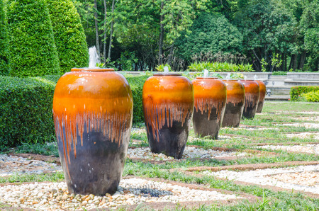 Many Jar fountain in garden photo
