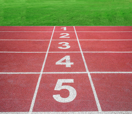athletics track: Start or finish position on running track with green field