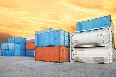 dockside: Stack of Cargo Containers and liquid  tank at the docks