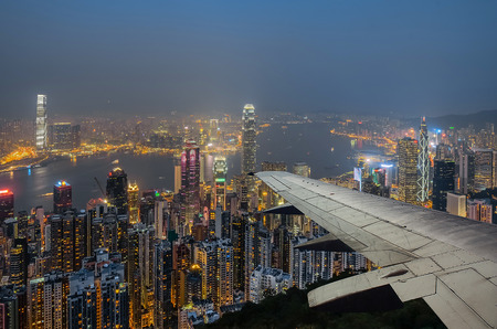 hong kong night: Victoria harbour Hong Kong in night from air plane view Stock Photo