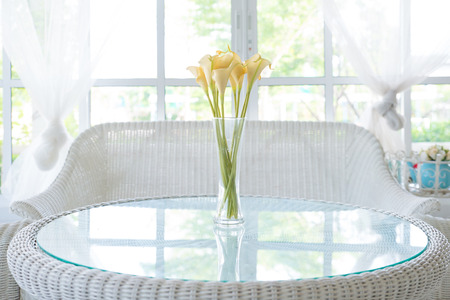 sill: Yellow flower in vase on table and window sill background  Vintage style decorate Stock Photo