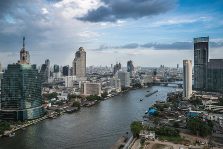 Bangkok Transportation at Dusk with Modern Business Building along the river  Thailand  photo