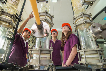 Group of engineer students university looking in machine in laboratory Stock Photo