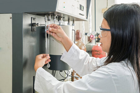 research facilities: Scientist using chemical machine autosorb  in laboratory