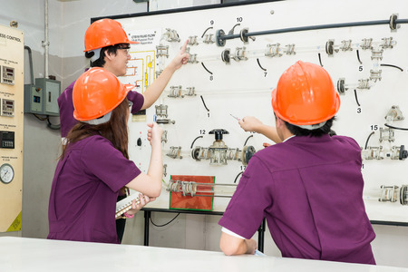 construction plant: Engineer student looking part of machine in laboratory