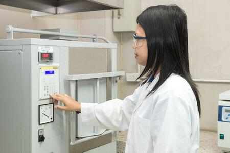 muffle: Scientist using High Temperature Muffle Furnace in laboratory