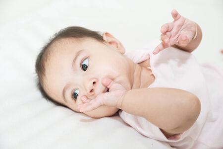 sucks: Asian baby sucks his fingers