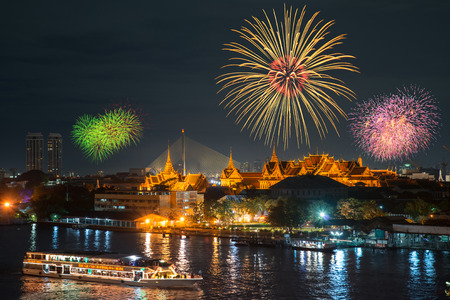 Grand palace and cruise ship in night with fireworks